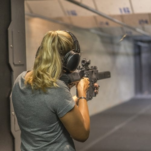 A woman shooting at Caswells Shooting Range
