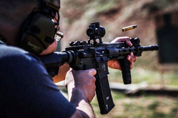 An experienced shooter firing a gun
