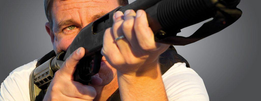 Man holding shotgun