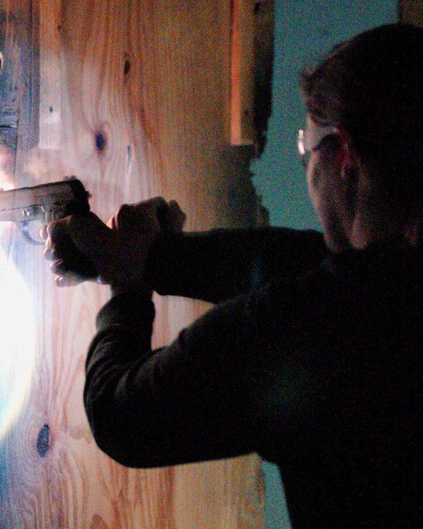 A woman shooting at Caswells Shooting Range